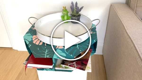 Ver en Cosmo - vídeo DIY mesita revistero con carpeteros