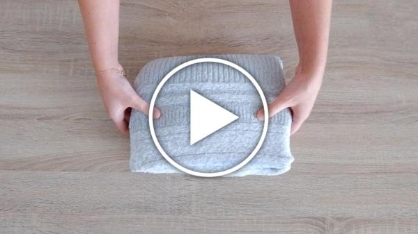Ver en Cosmo vídeo - cómo doblar jerséis gruesos